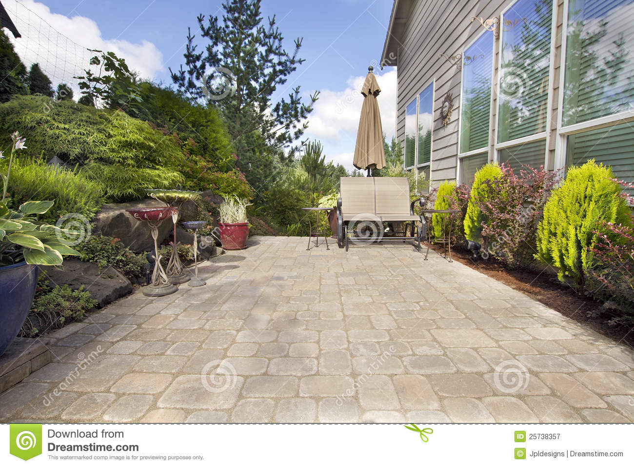 free stock photography backyard paver patio with garden accessories