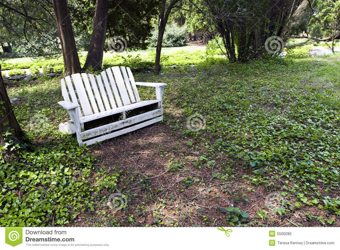 Backyard Sounds At Night : Relaxing backyard retreat featuring a white wooden seat surrounded by