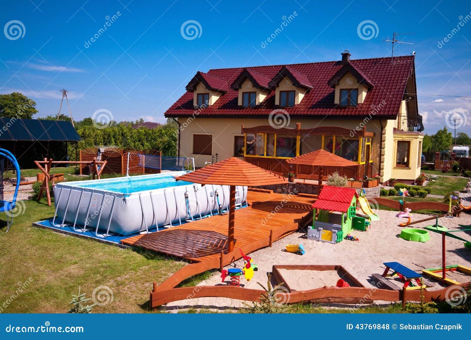 Backyard With Swimming Pool And Sandbox Stock Photo