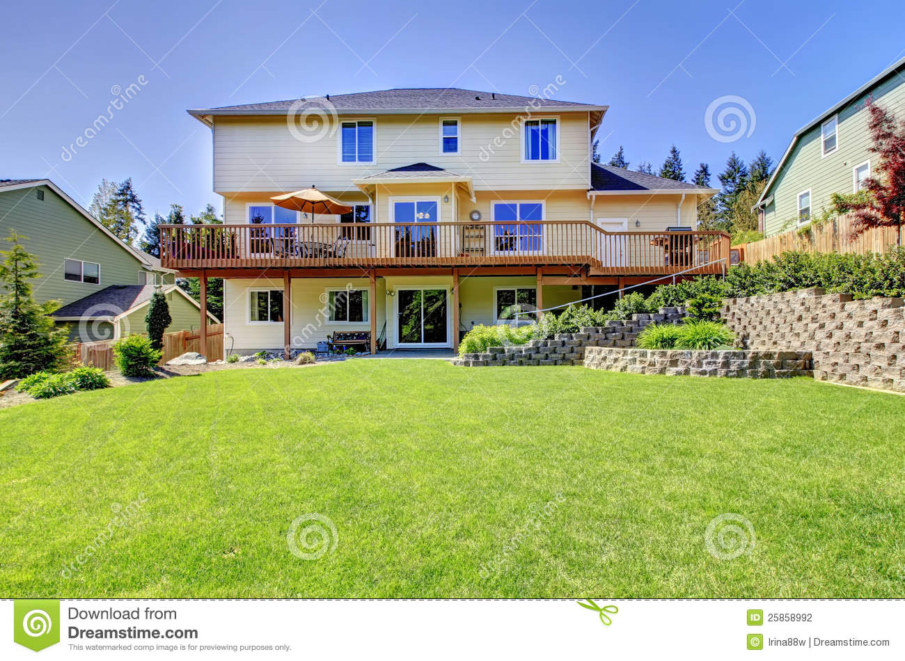 Backyard Of Three Story House With Fenced Yard Stock