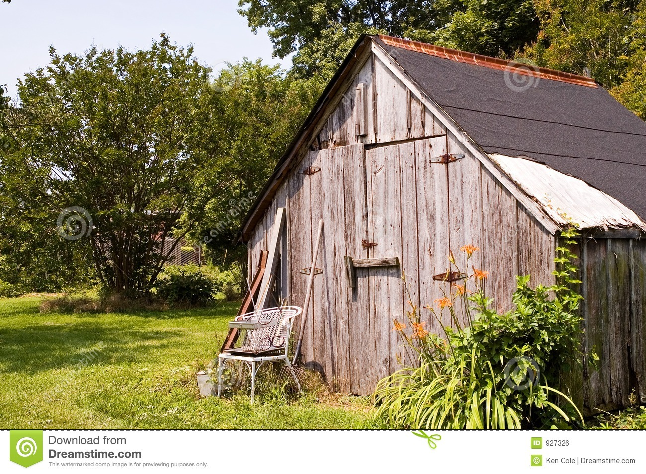 Backyard tool storage shed stock photo image of back for Utility storage shed
