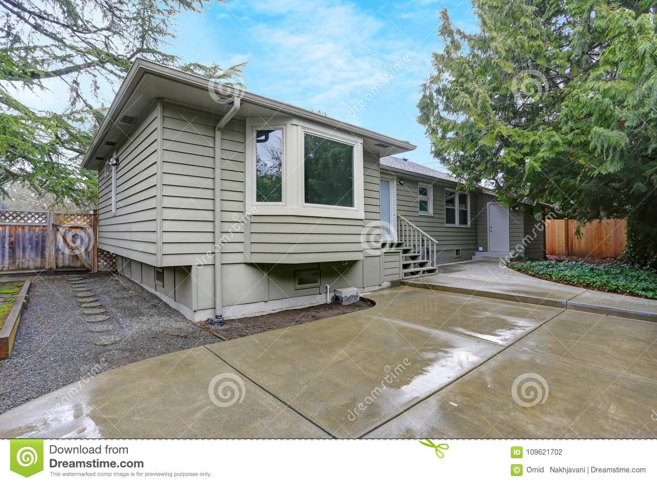 Backyard View Of A Small Home On A Rainy Day Stock Photo ... on riverside home, sunny day home, garden home, easter home, gloomy day home, cloudy day home, fun home, health home, black and white home, paul reubens home, cold home, blu home, farm home,