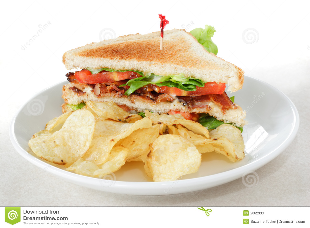 Bacon lettuce and tomato sandwich on toasted bread served with potato ...