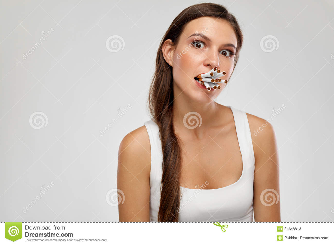 Bad Habit. Young Woman With Bunch Of Cigarettes In Mouth