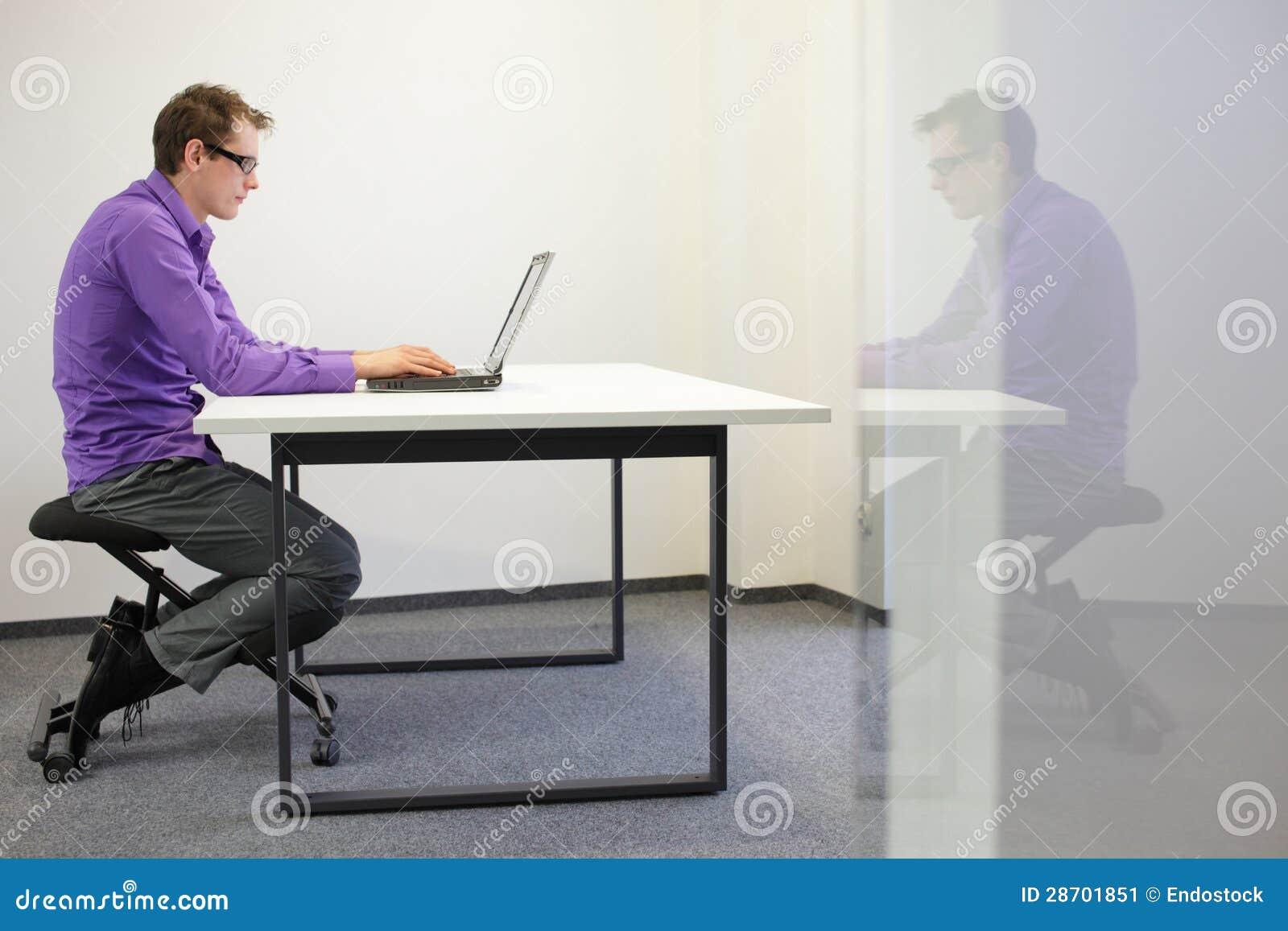 Bad Sitting Posture At Workstation Man On Kneelin Stock