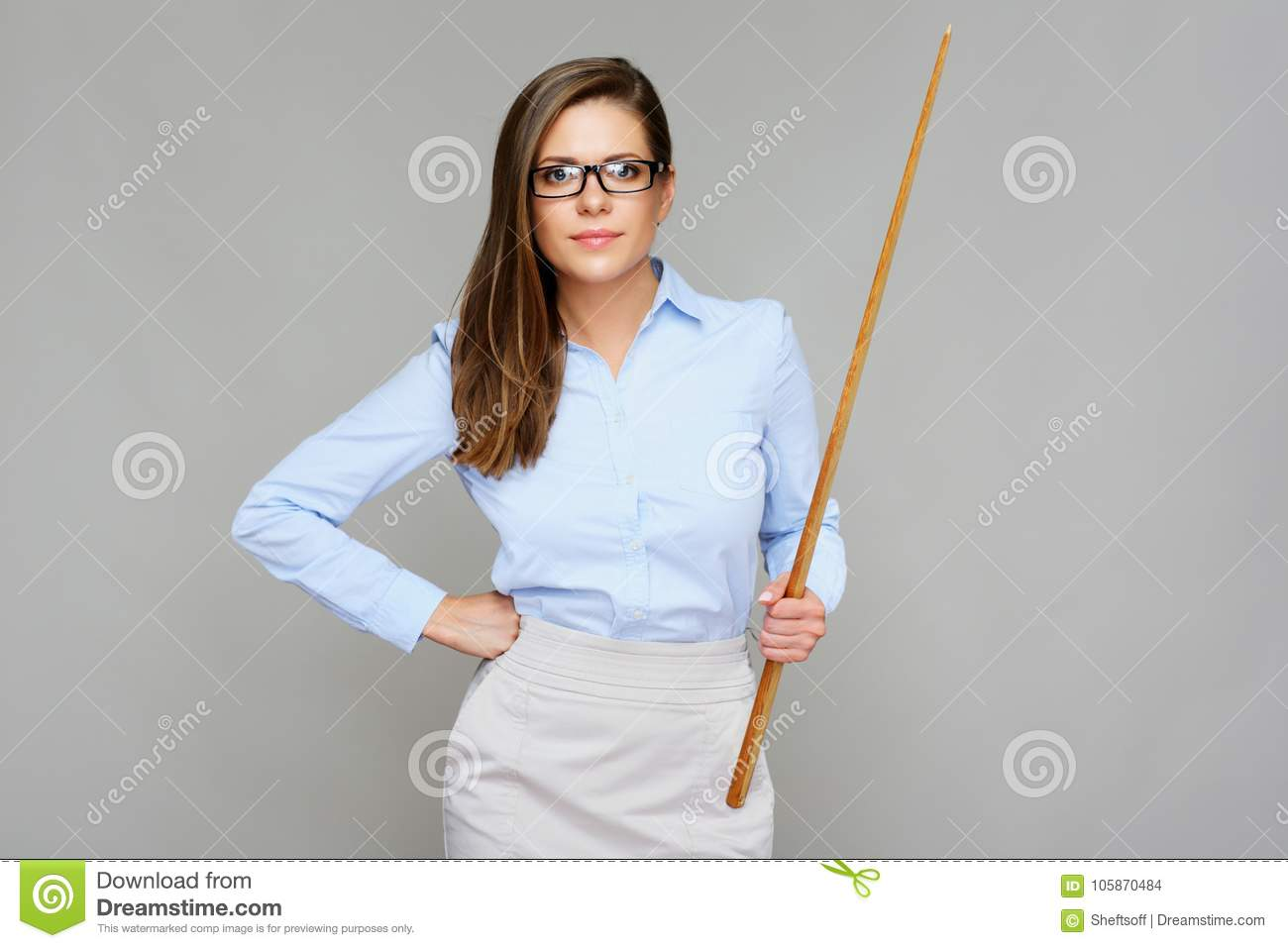 Bad teacher. Woman holding wooden pointer.