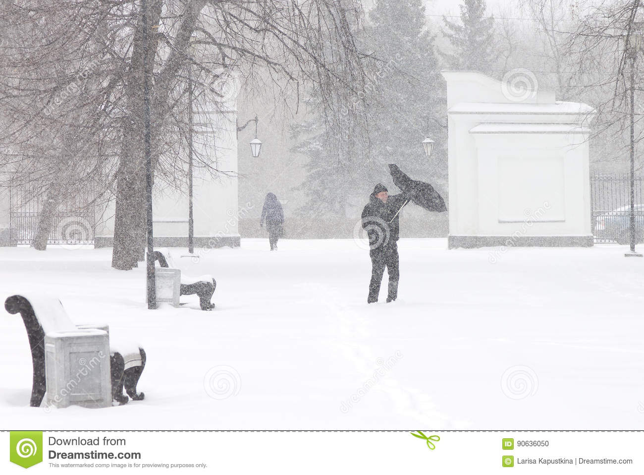 Bad weather in a city: a heavy snowfall and blizzard in winter