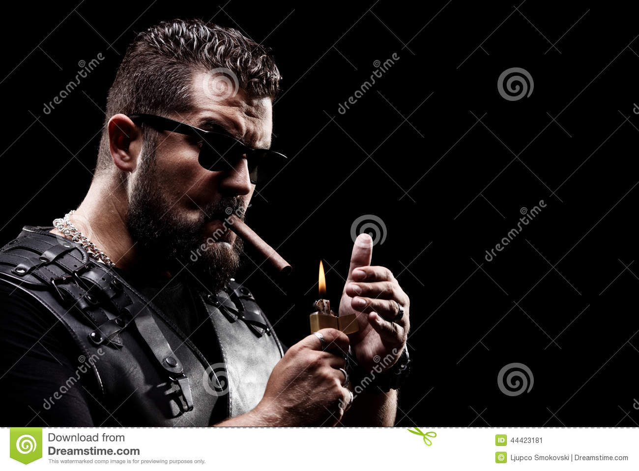 Badass biker lighting up a cigarette