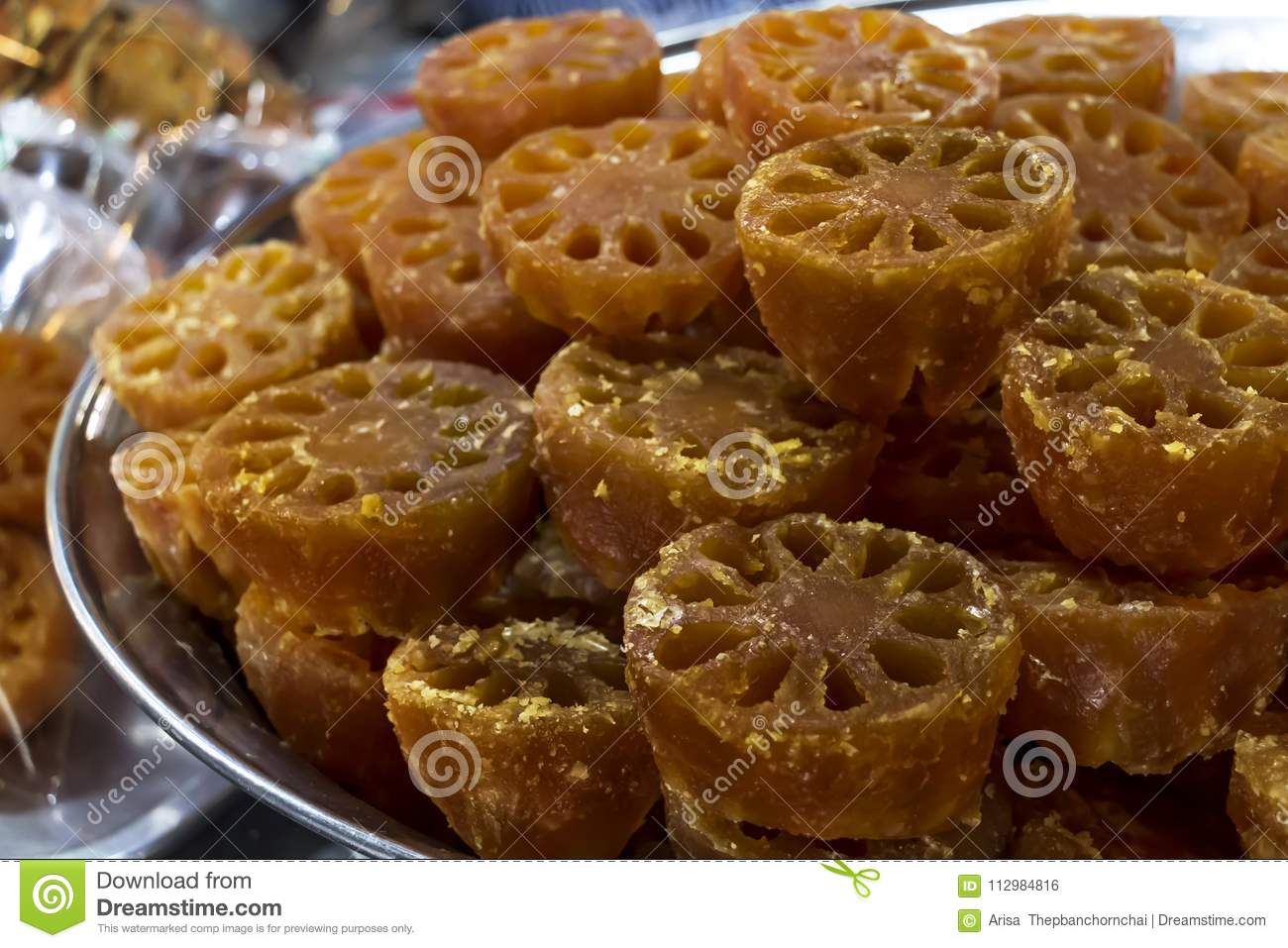 Bael fruit or Aegle marmelos preserved by sweet syrup on contain