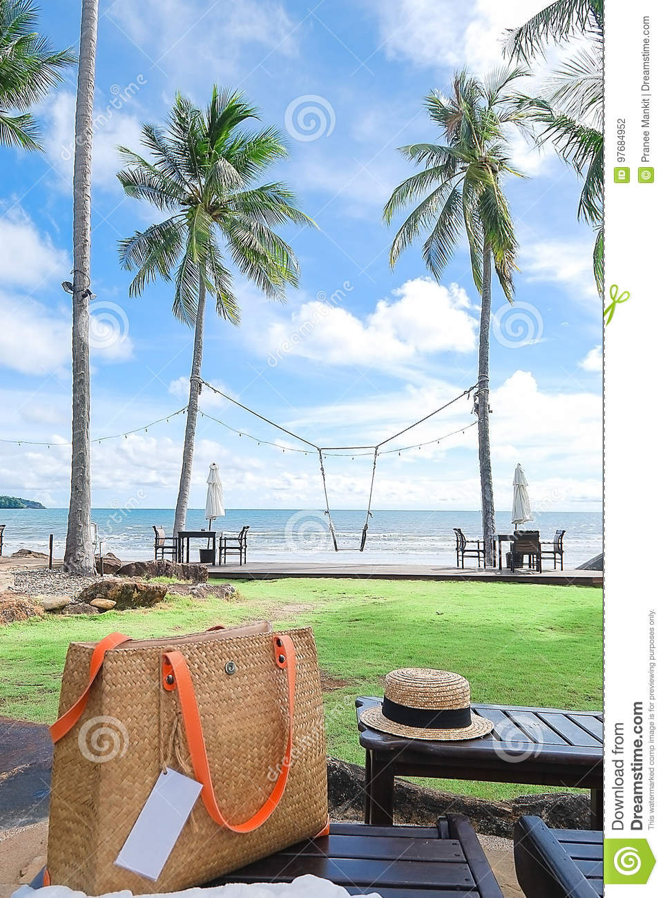 Bag And Hat On Beach Bed With Background Green Field Coconut Tr
