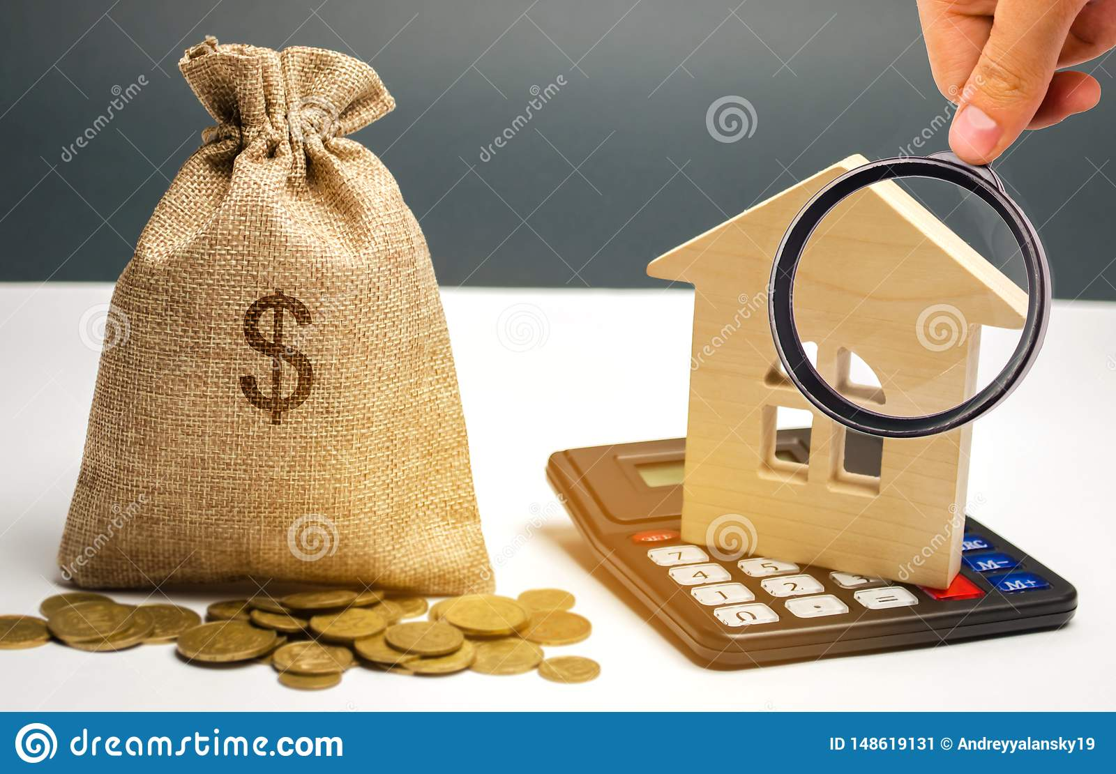 Bag with money and dollar sign and wooden houses. Financing in the country. Investing money in real estate. Saving and