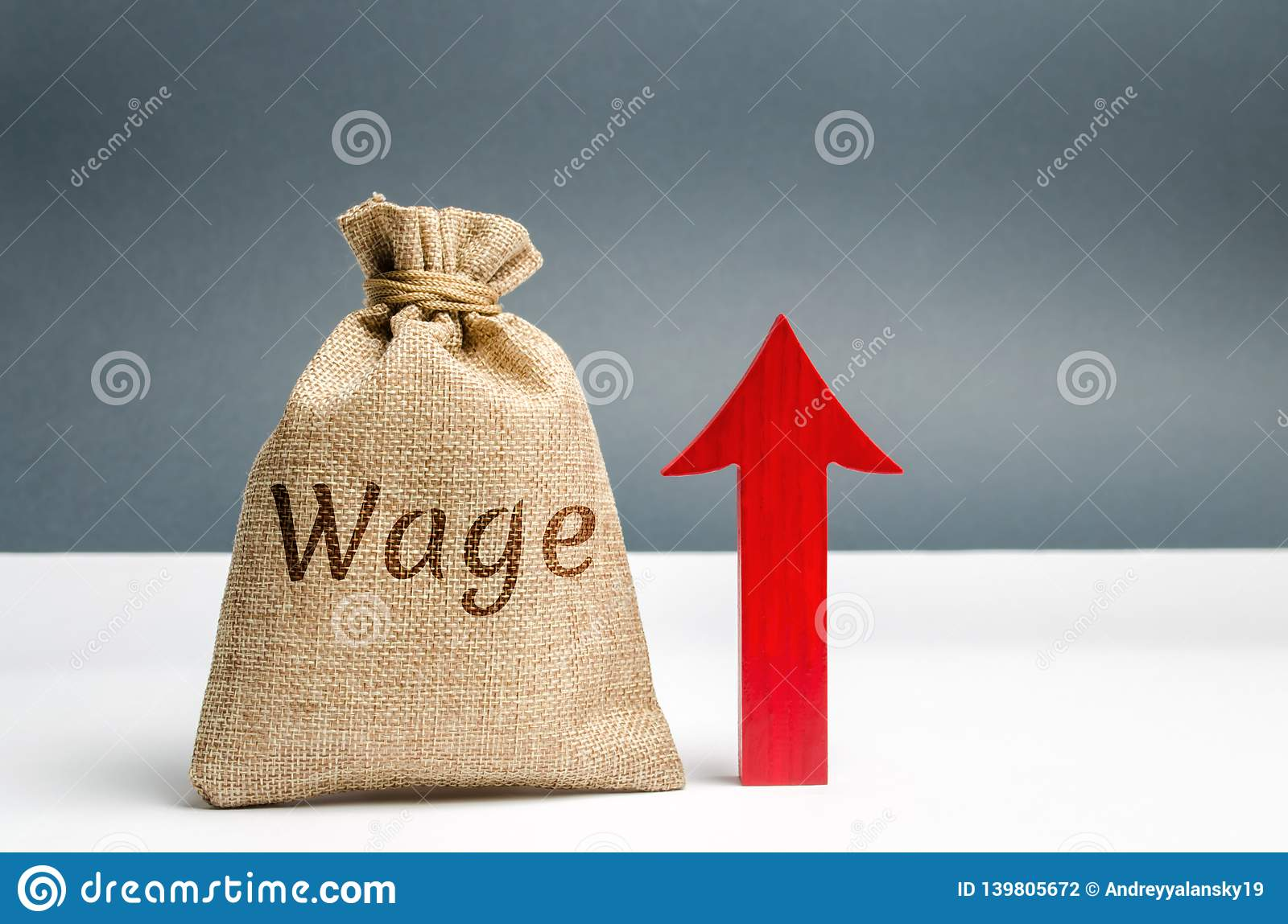 Bag with money and word Wage and up arrow. Increase of salary. Wage rates. Career growth. Increase profits and family budget.