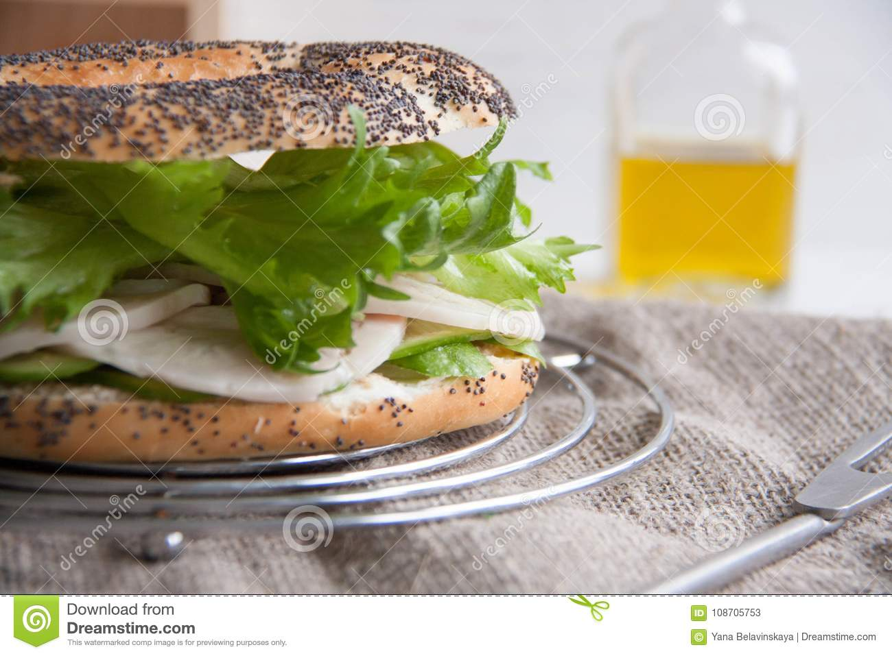 Bagel with chicken roll, green salad and cream cheese