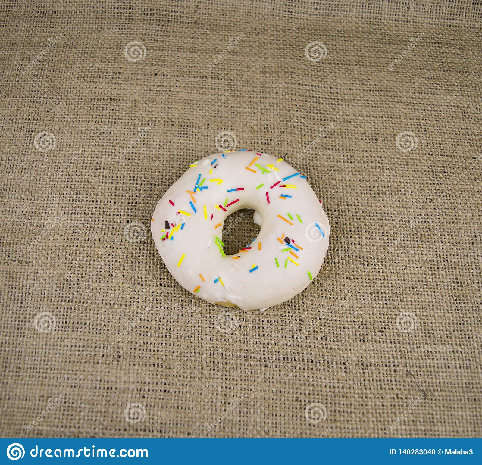 Bagel sprinkled with colored glaze, there is free space to fill
