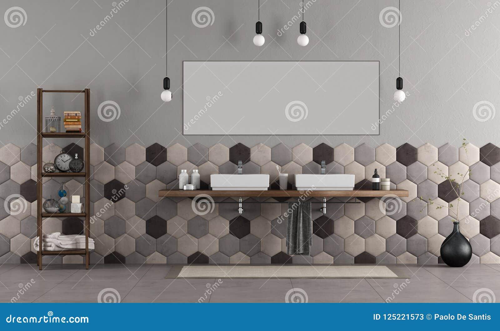 Bagno con il doppio lavandino e le mattonelle esagonali