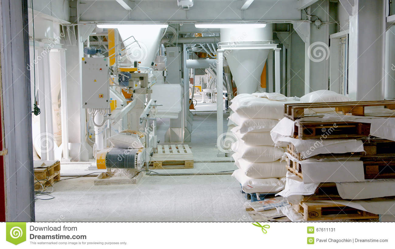 bags with flour in warehouse of flour factory flour stock mill