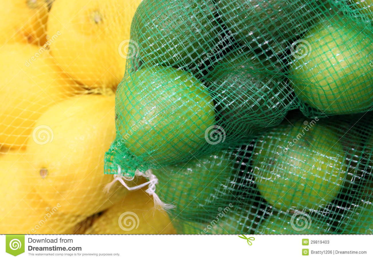 Netting bags with lemons and limes