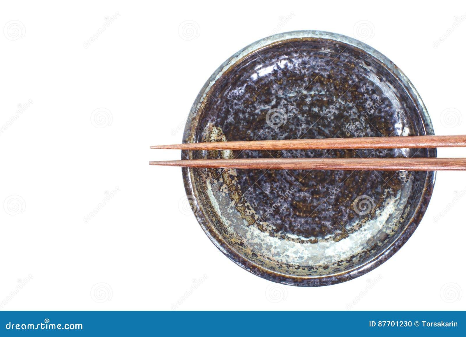 Baguette en céramique de plat et en bois