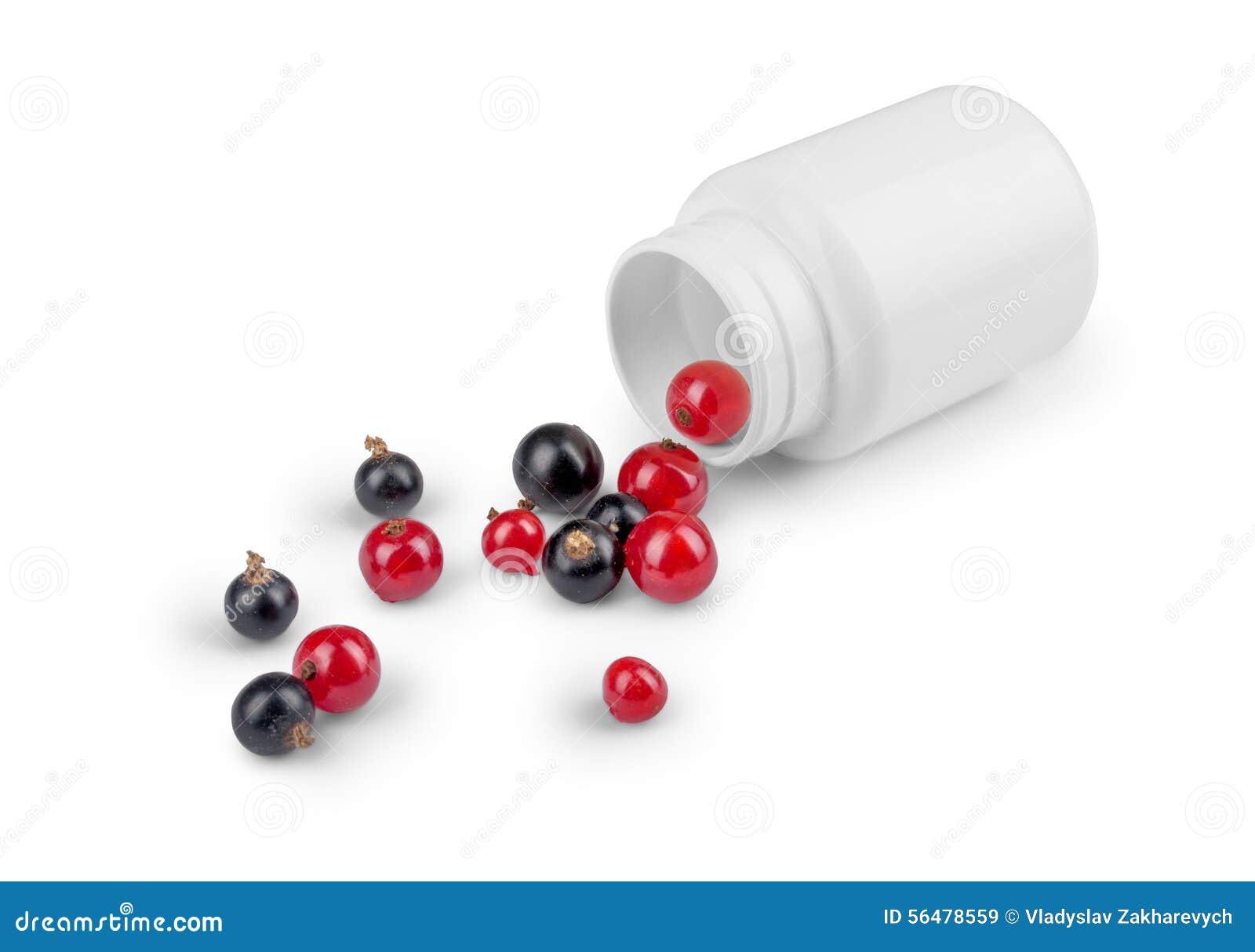 Baies se renversant hors de la bouteille de pilules
