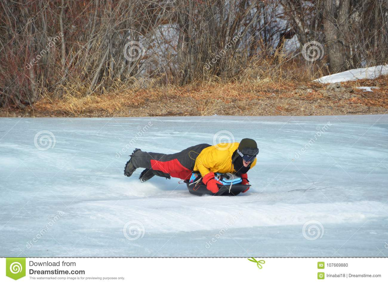 Baikal lake, Russia, March, 01, 2017. Tourist riding on a sled sledges MS icy shores of lake Baikal