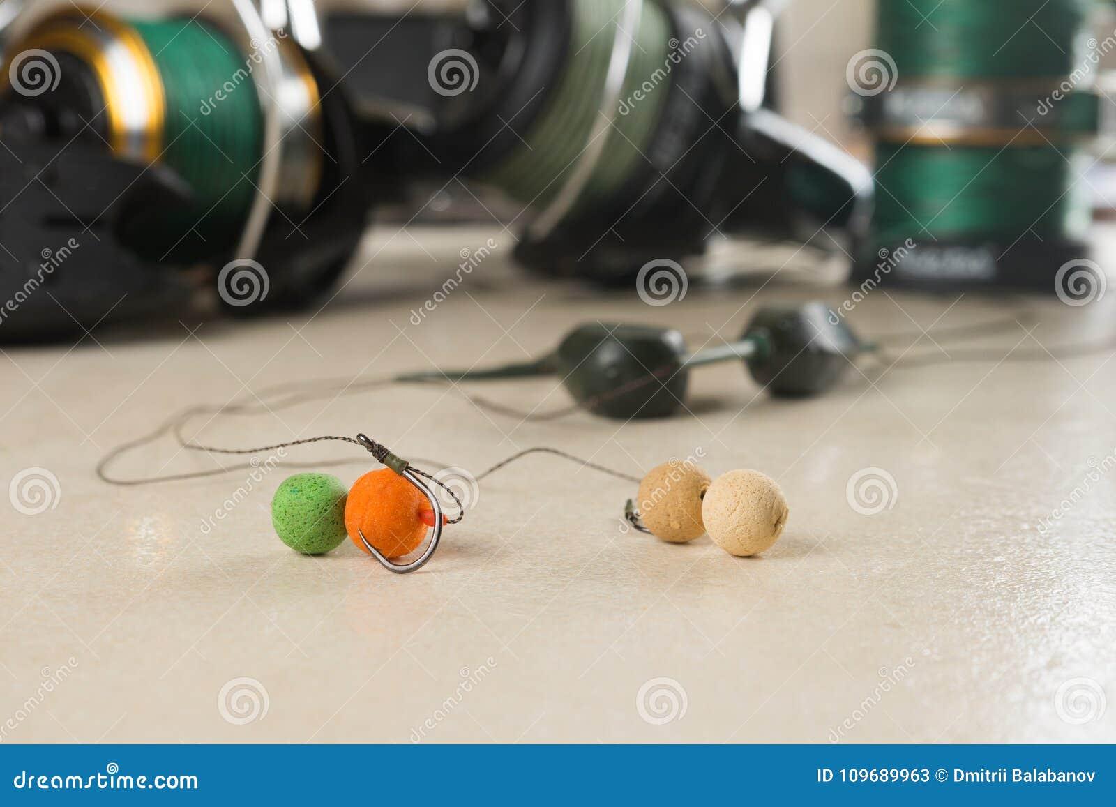 Baits, hooks, sinkers, reels, is preparing for carp fishing. Copy paste