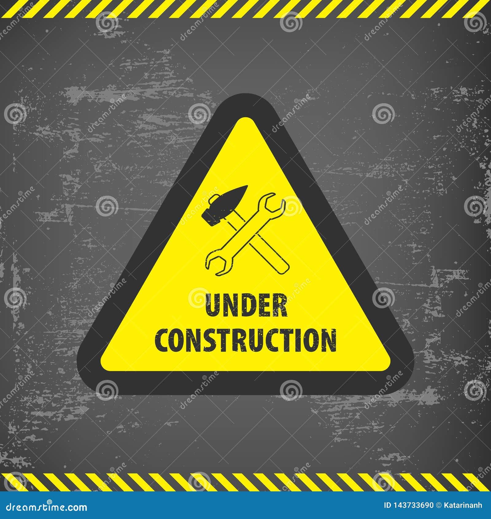 Bajo muestra de la construcción en fondo de tierra gris Ejemplo del vector para el sitio web Bajo triángulo de la construcción co