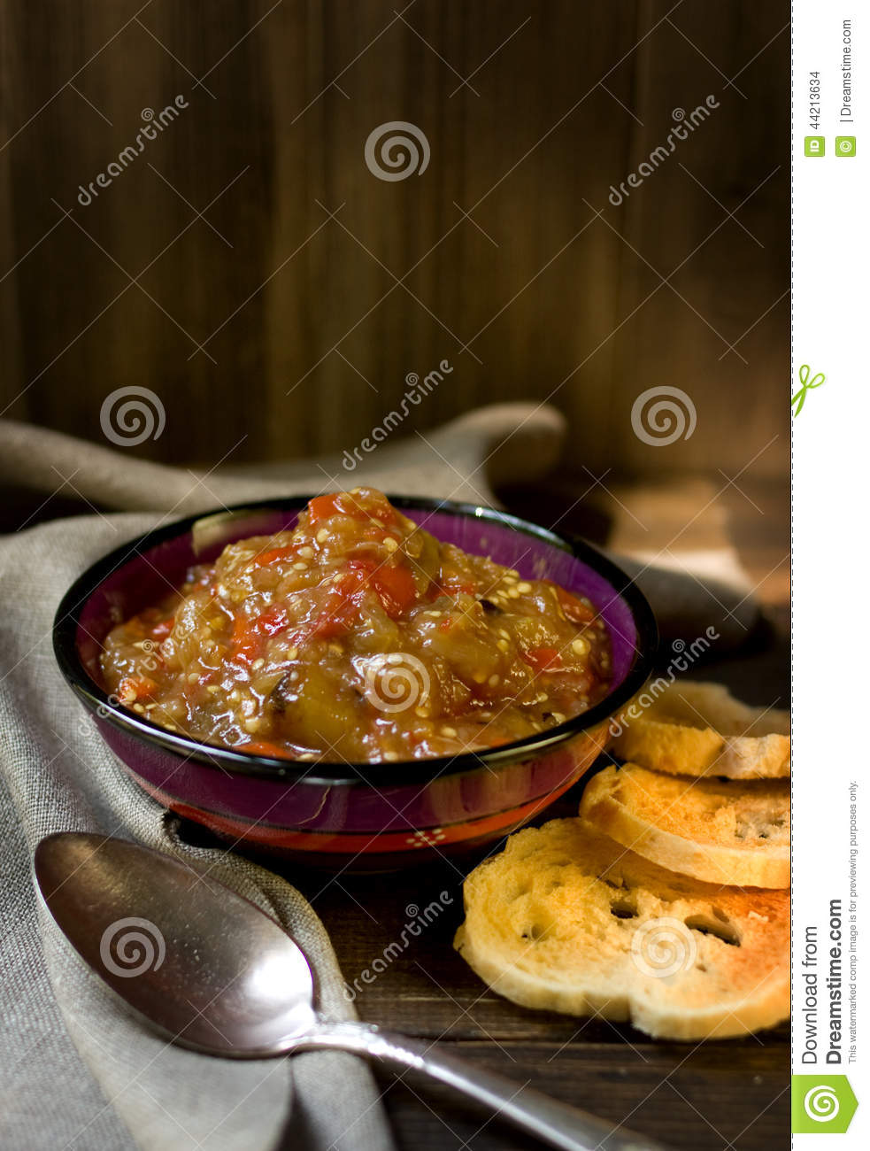 Bake eggplant salad with toasted white bread.