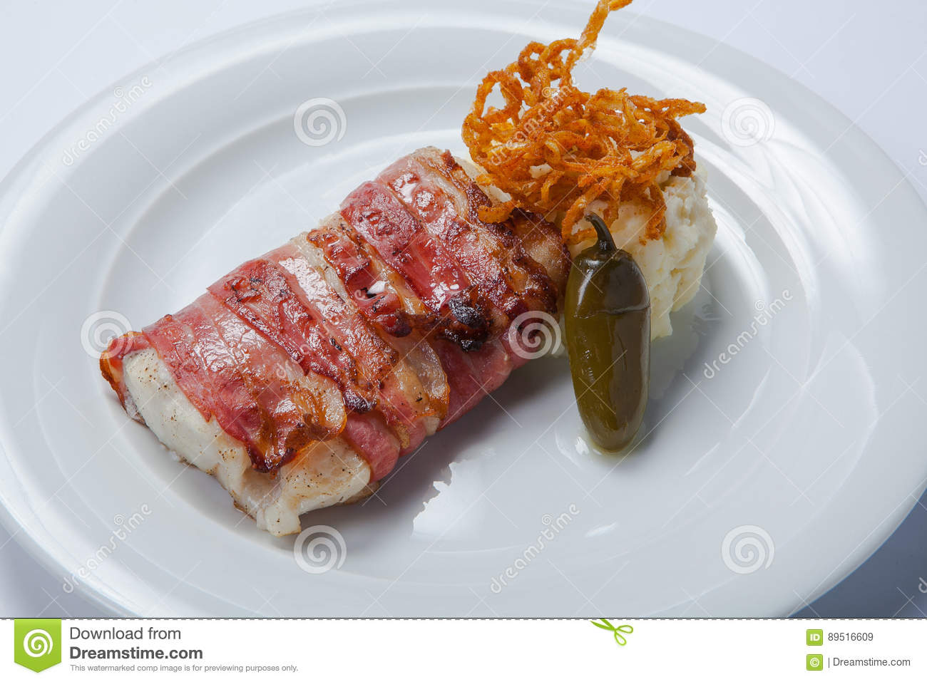 Baked Cod Wrapped In Bacon And Mashed Poatoes Stock Photo - Image ...