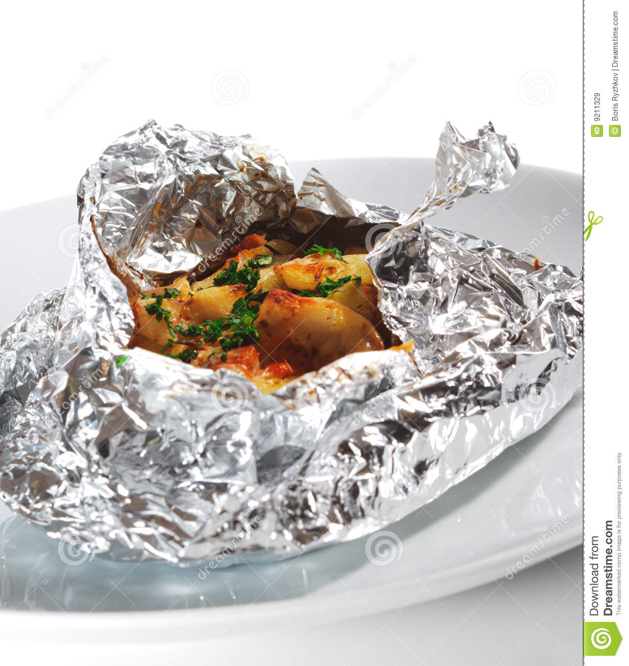 Baked fish in foil stock image image of mediterranean for Cooking fish in foil