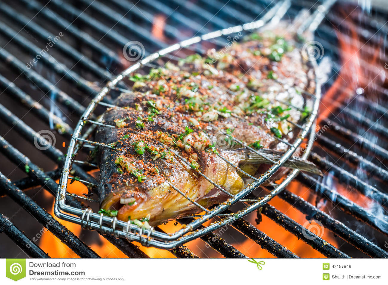Baked fish on the grill with fire stock photo image for Fish on fire