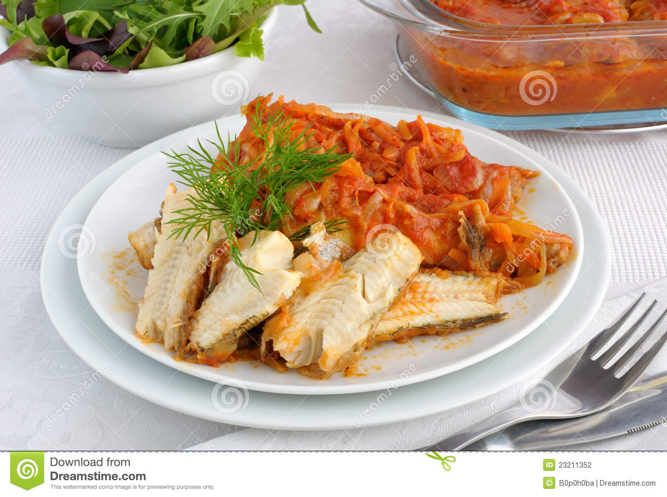 Baked fish in tomato sauce with vegetables stock for Fish in tomato sauce