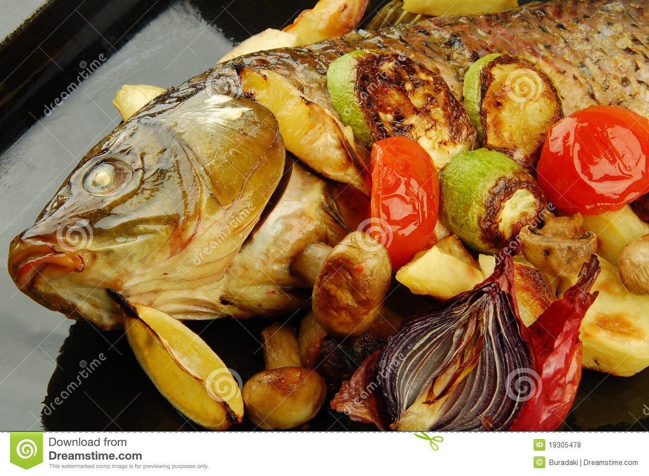 Baked fish with vegetables royalty free stock photos for What vegetables go with fish