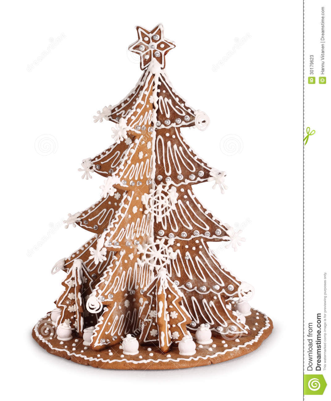 Baked Gingerbread Christmas tree decoration with sugar icing.
