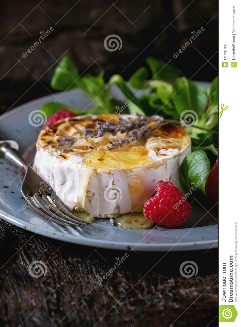 Baked Goat Cheese With Honey And Raspberries Stock Photo ...