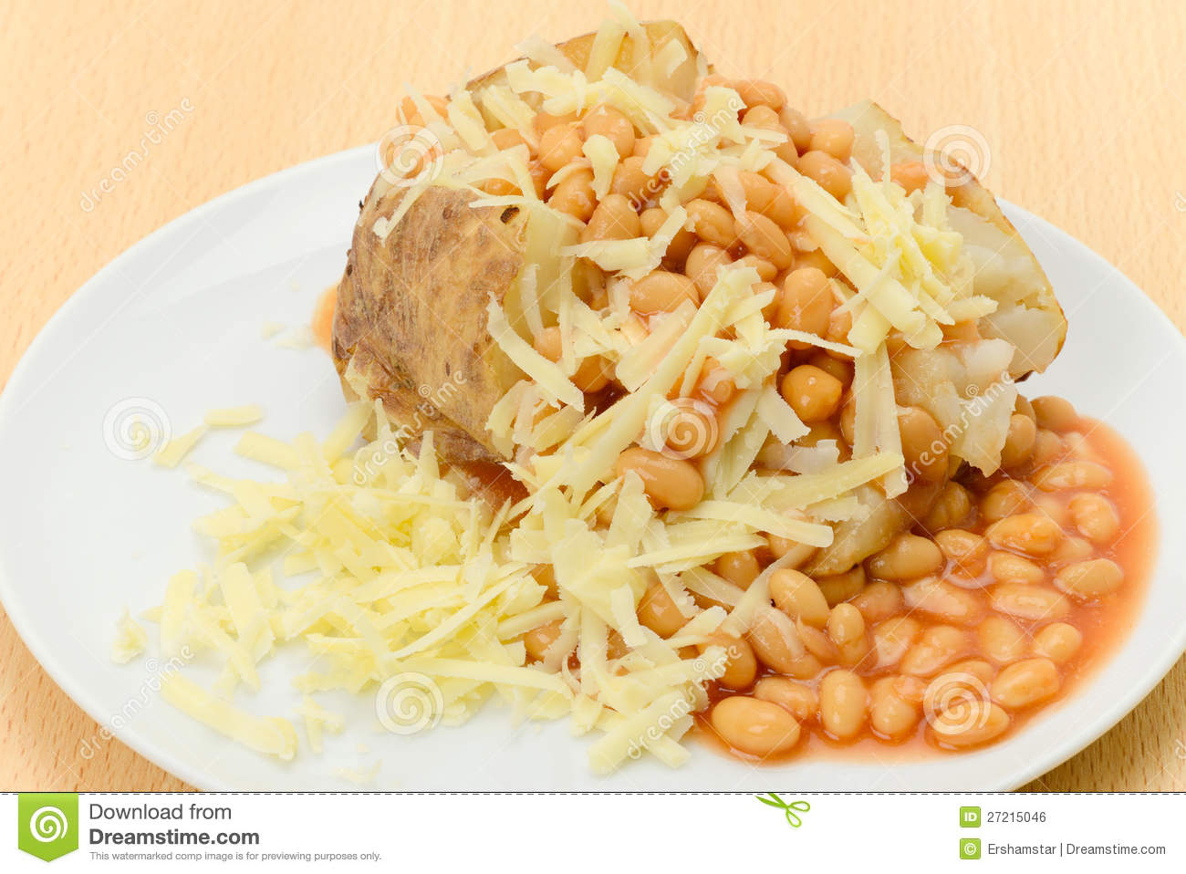 baked jacket potato filled with beans and topped with grated cheese ...