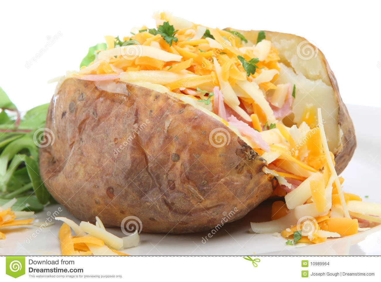 Baked potato stuffed with ham and grated cheeses.