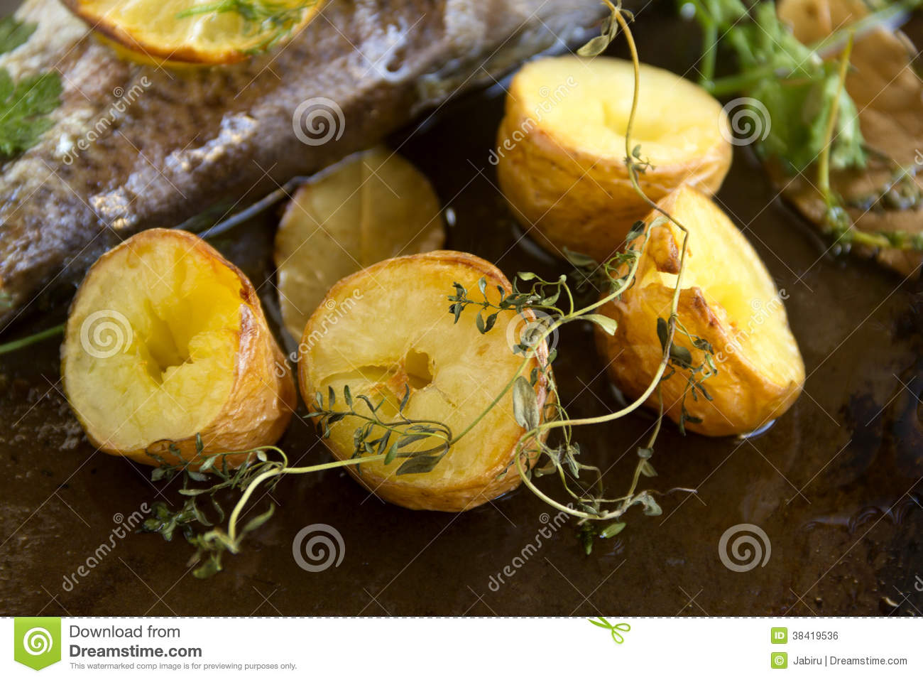 Baked Potatoes And Thyme Royalty Free Stock Image - Image: 38419536