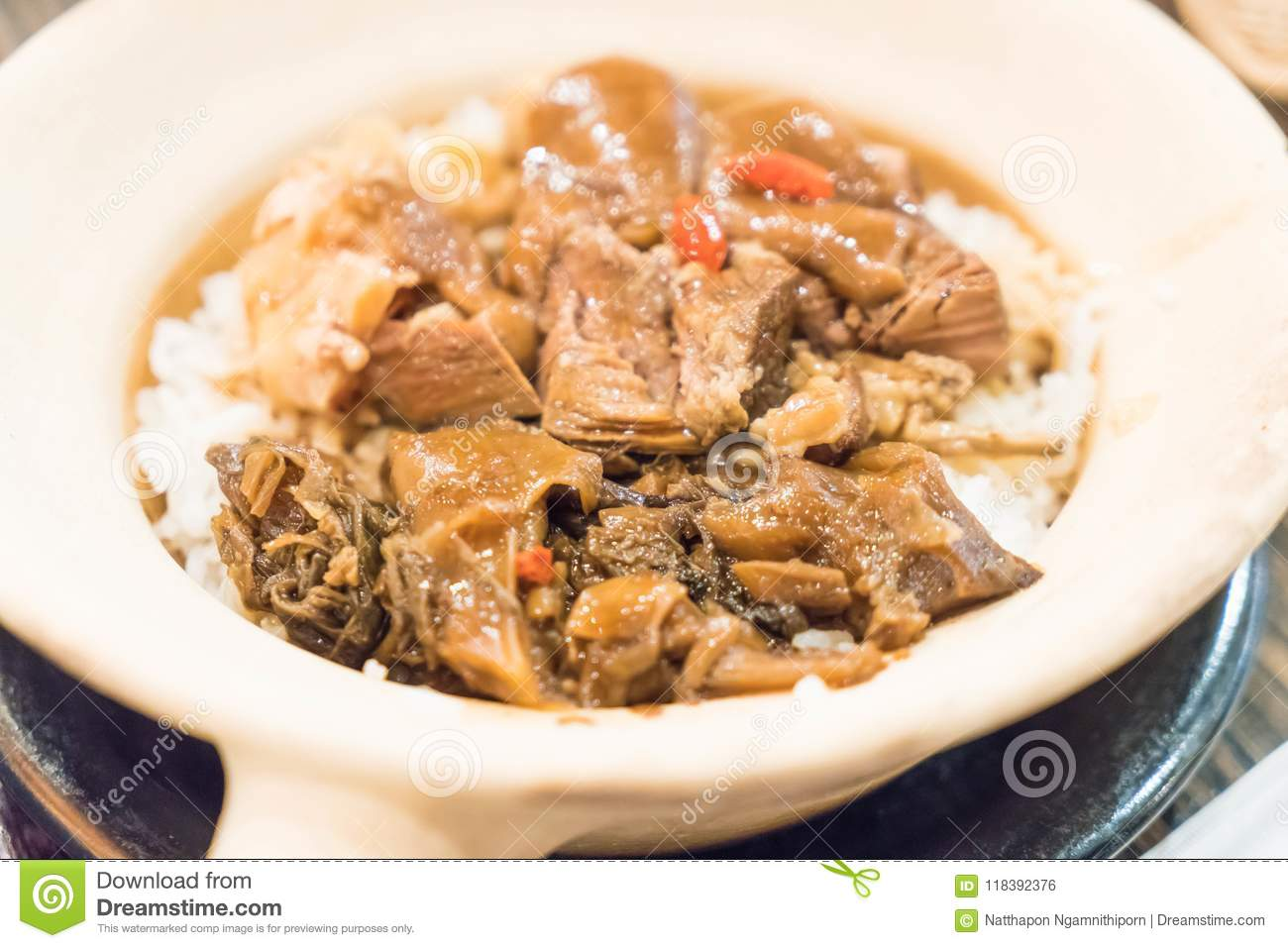 Baked rice with stewed pork leg in clay pot