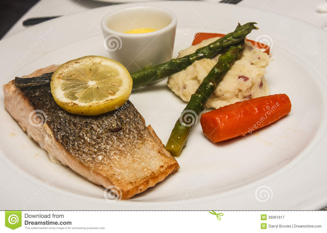 Baked Salmon served with mashed potatoes , asparagus and carrots ...
