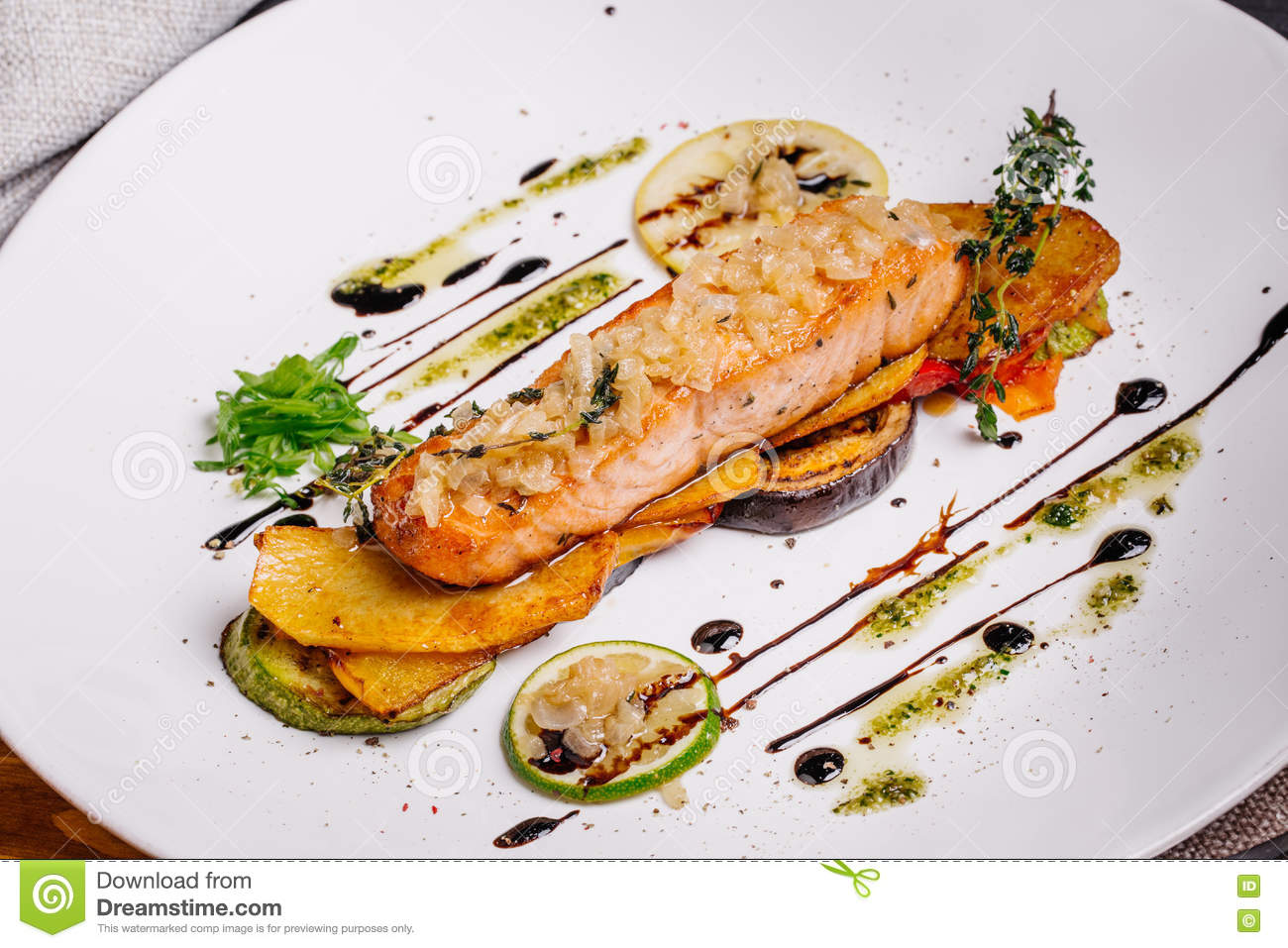 Baked Salmon With Vegetables On Glass Plate Isolated