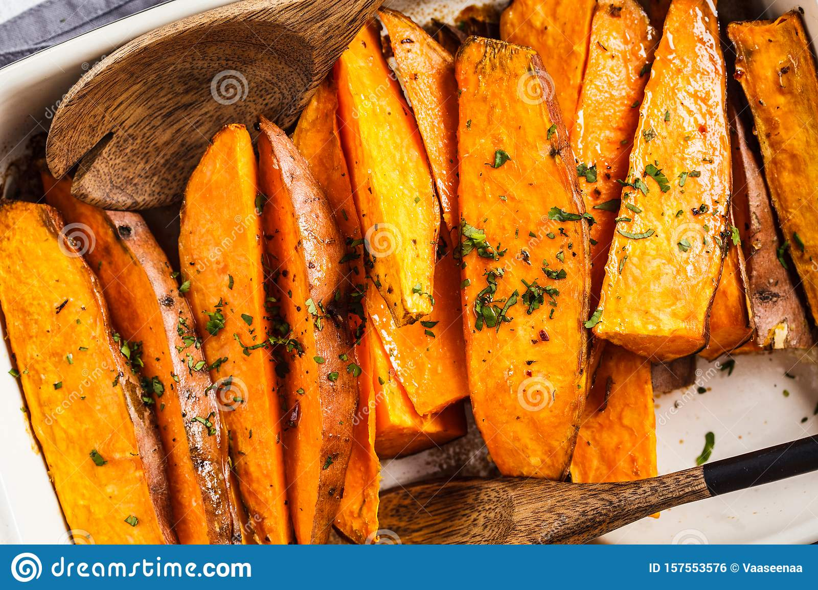 Baked Sweet Potato Slices With Spices In Oven Dish Healthy Vegan Food Concept Stock Photo Image Of Roasted Recipe 157553576