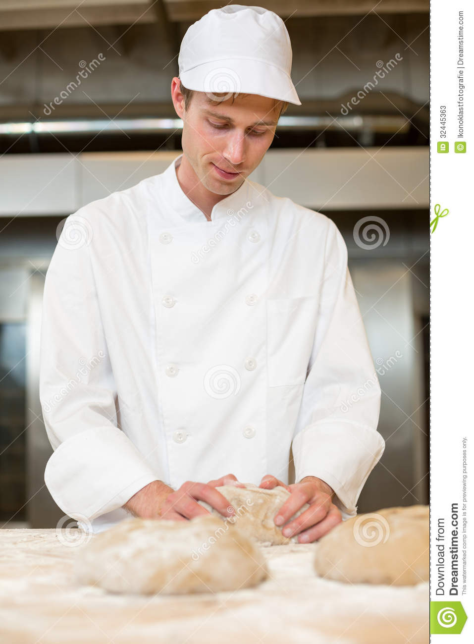 Baker Kneading Dough In Bakery Or Bakehouse Stock Photos - Image: 32445363