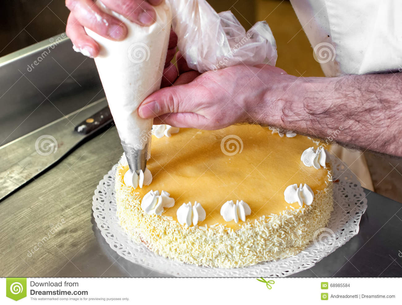 Cake Decorating Stock Images : Baker Piping Cream Decorations On A Cake Stock Photo ...