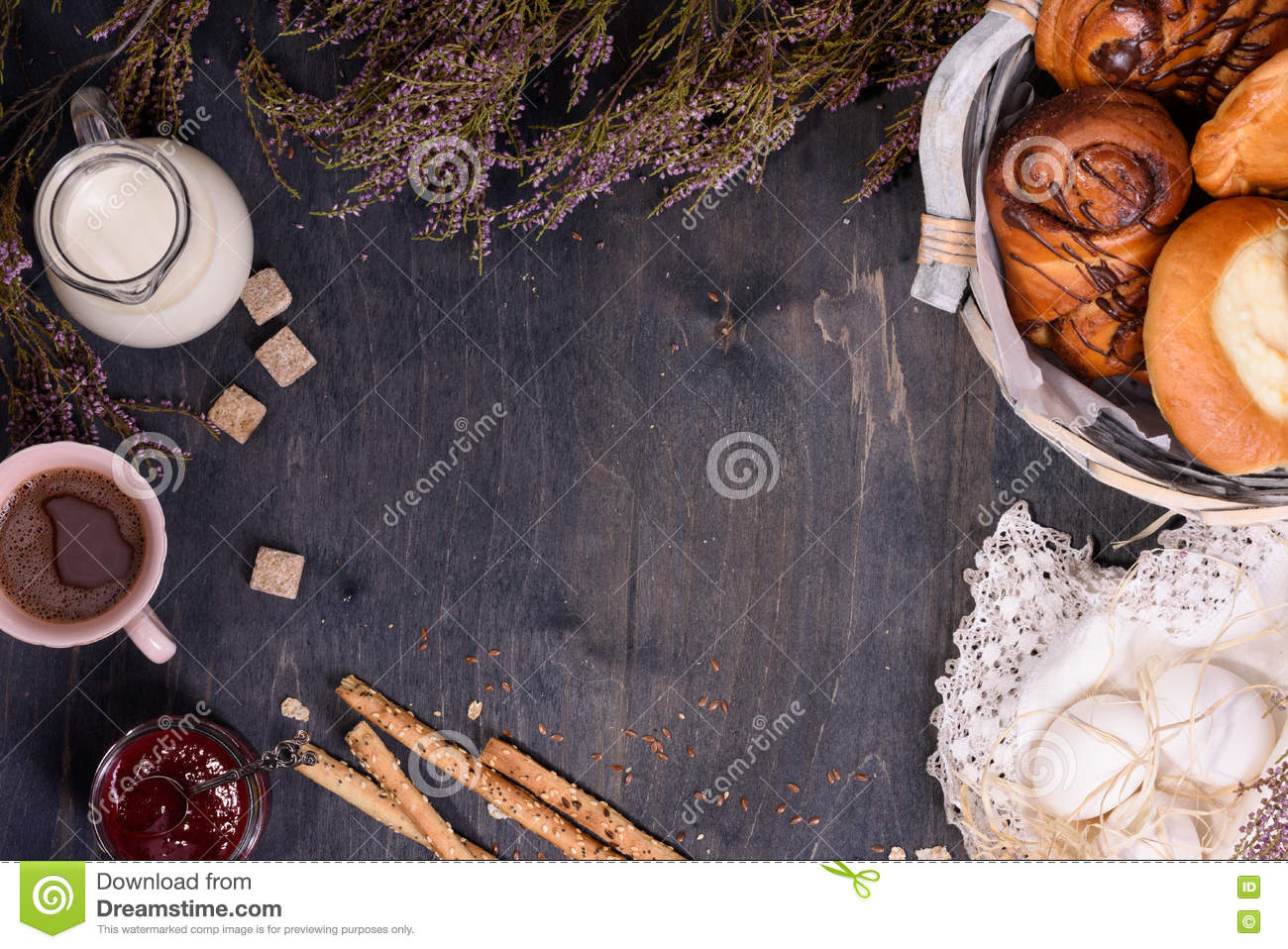 Bakery background with eggs, milk, sugar and sweet confectionery. Wooden table, copy space, top view.