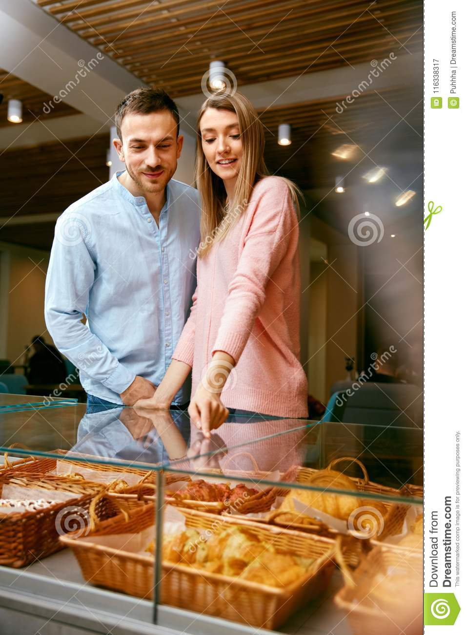 Bakery. Man And Woman In Pastry Shop
