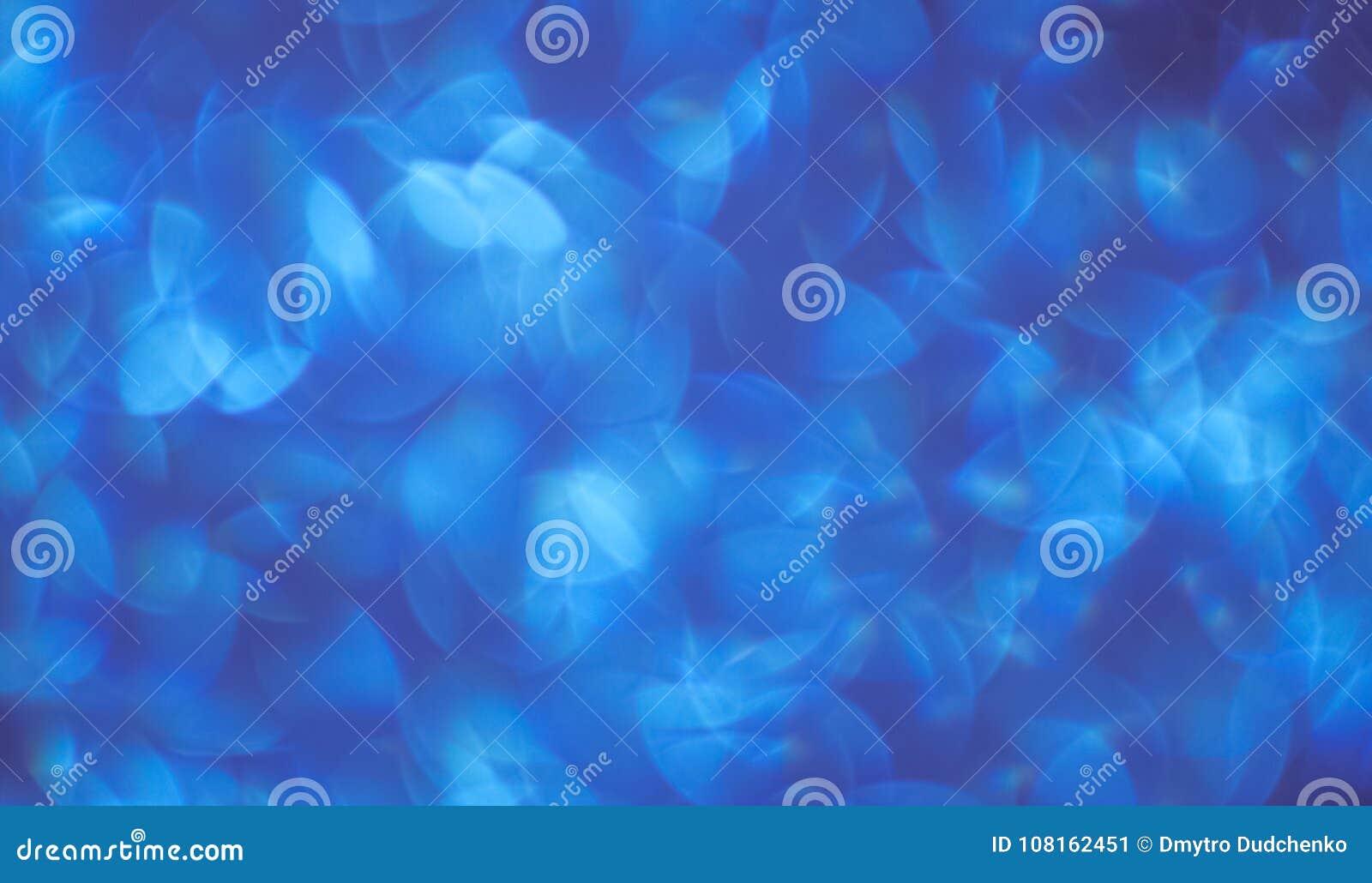 Bakgrund av härliga blått med vit bokeh bakgrunder och abstraktioner