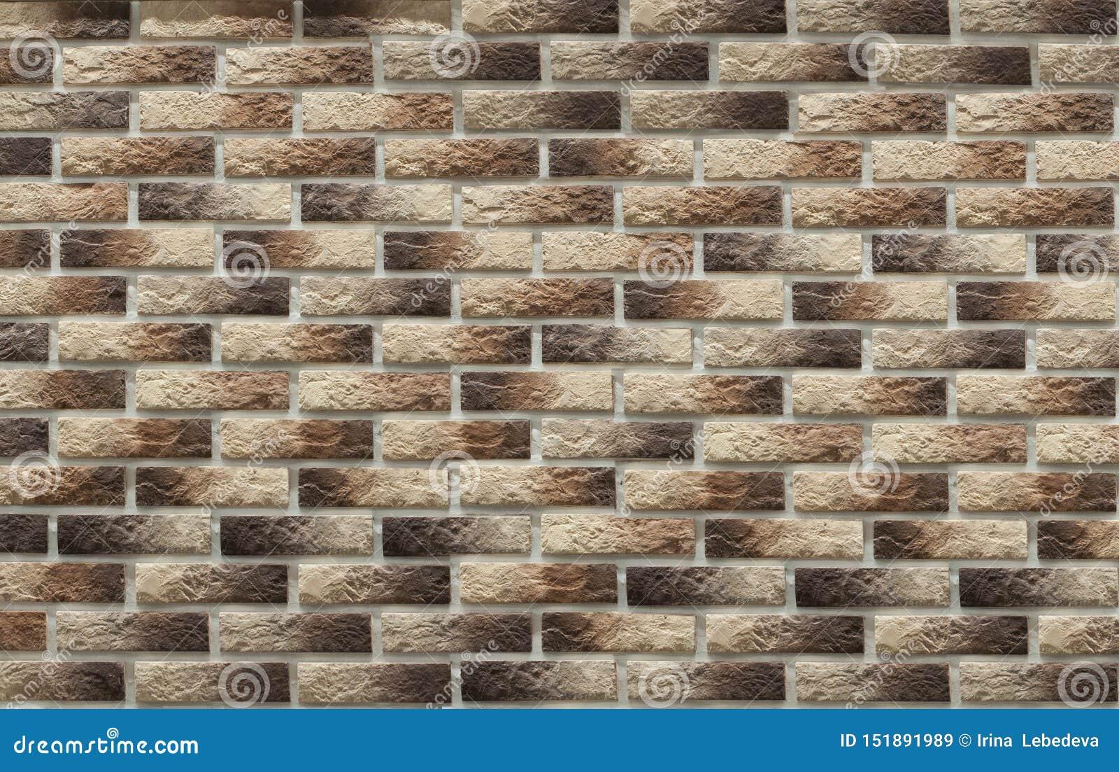 Bakgrund av tegelstenar för murverkbruntclinker på väggen, som används i reparationen av lokal
