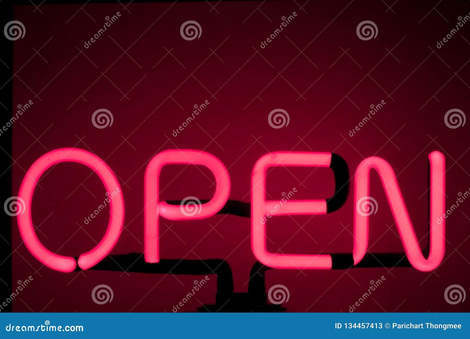 Bakgrund för rött för stång 'för öppet 'tecken för neon en glödande röd rosa glödande öppet ljust för neon för tecken lager för n