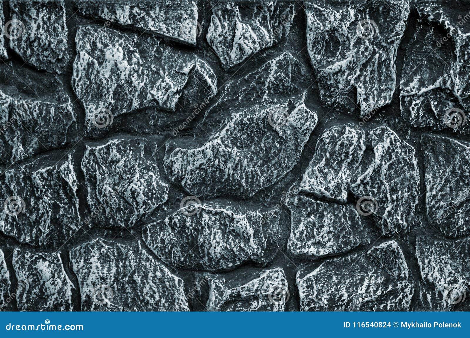 Bakgrund för stenvägg - byggnadssärdrag Textur av den tjocka och starka väggen av grova stenar av olika former och format
