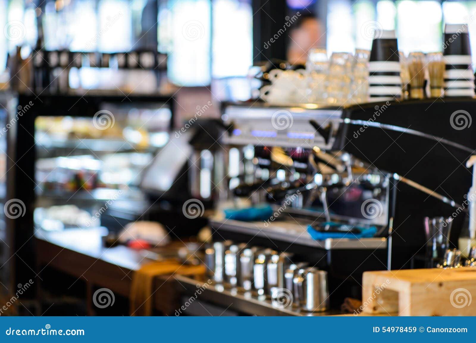 Bakgrund för suddighet för coffee shoplagerfokus